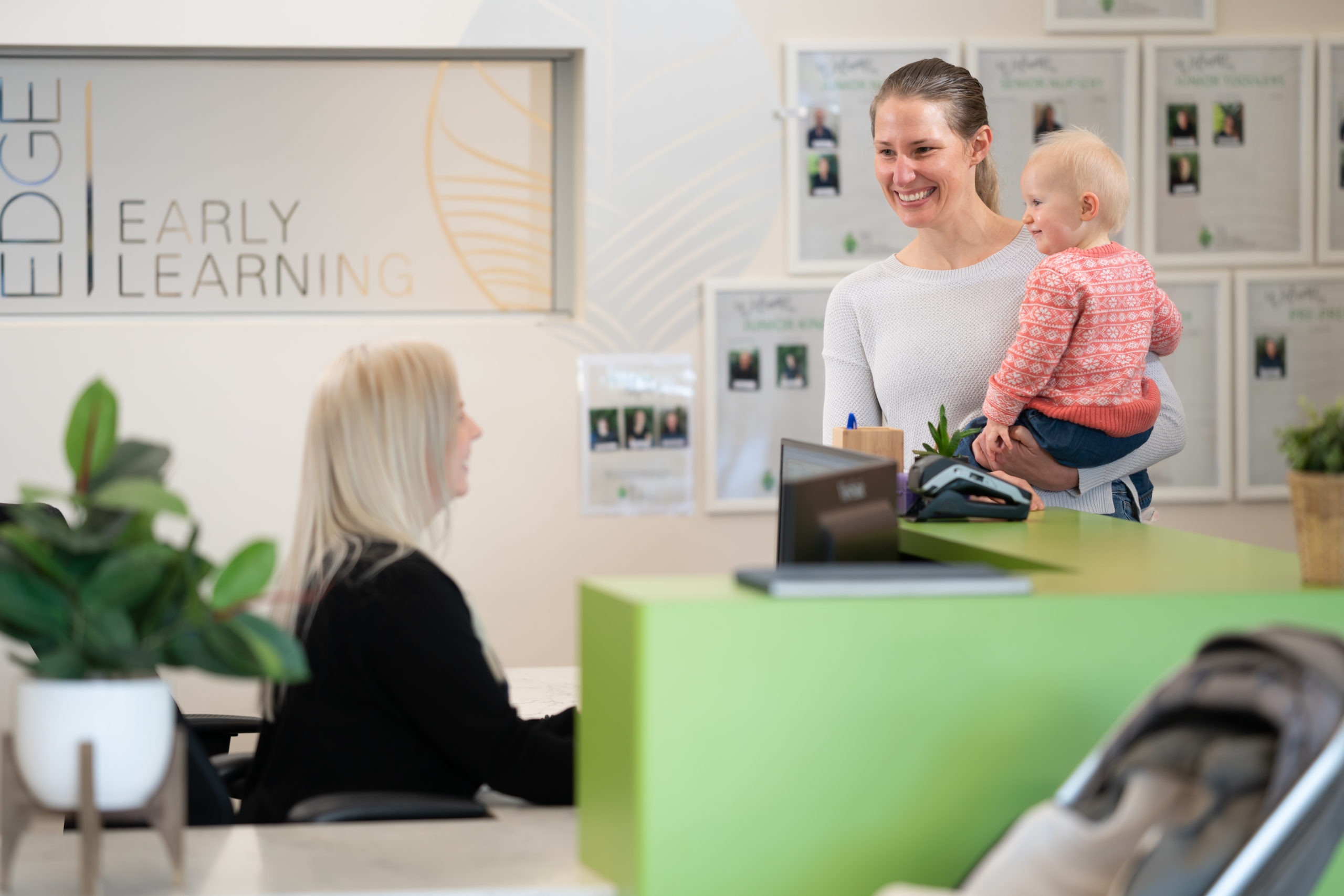 Mum checking in baby to Edge Early Learning