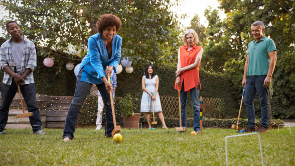 Family playing backyard games together