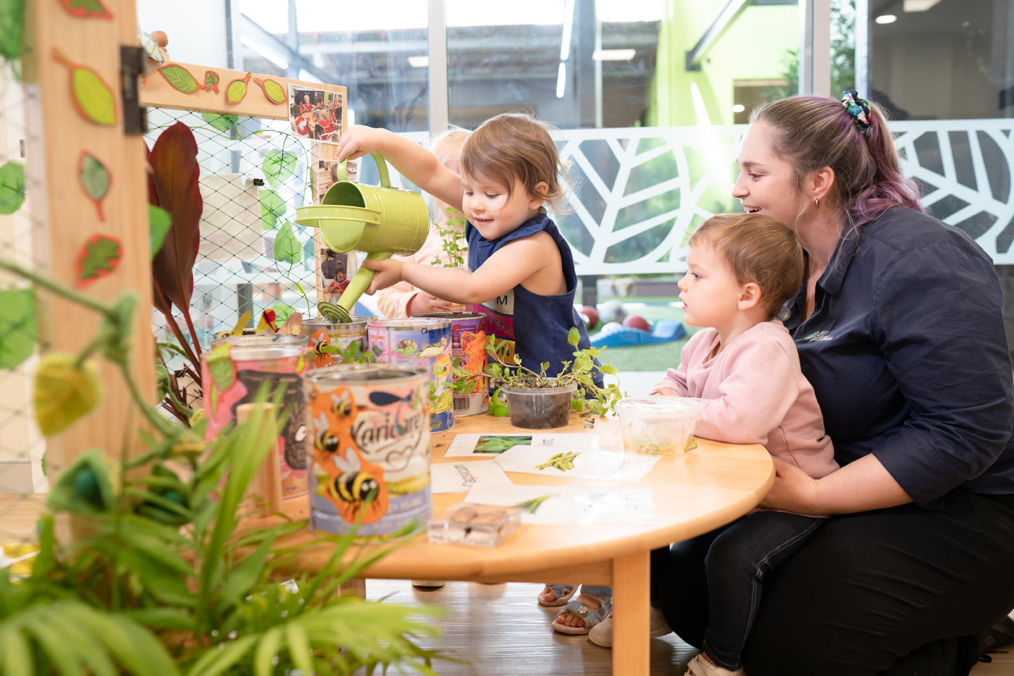 Edge Early Learning teacher gardening with kids