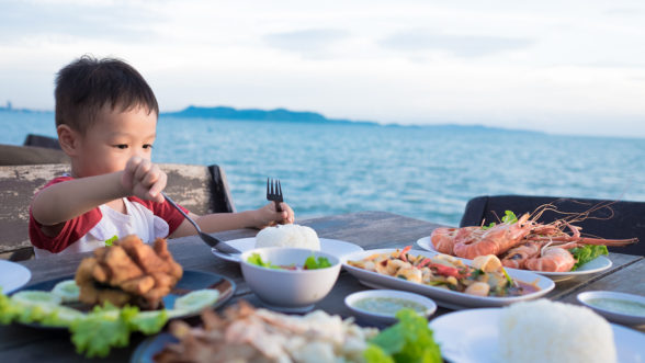 boy eating seafood