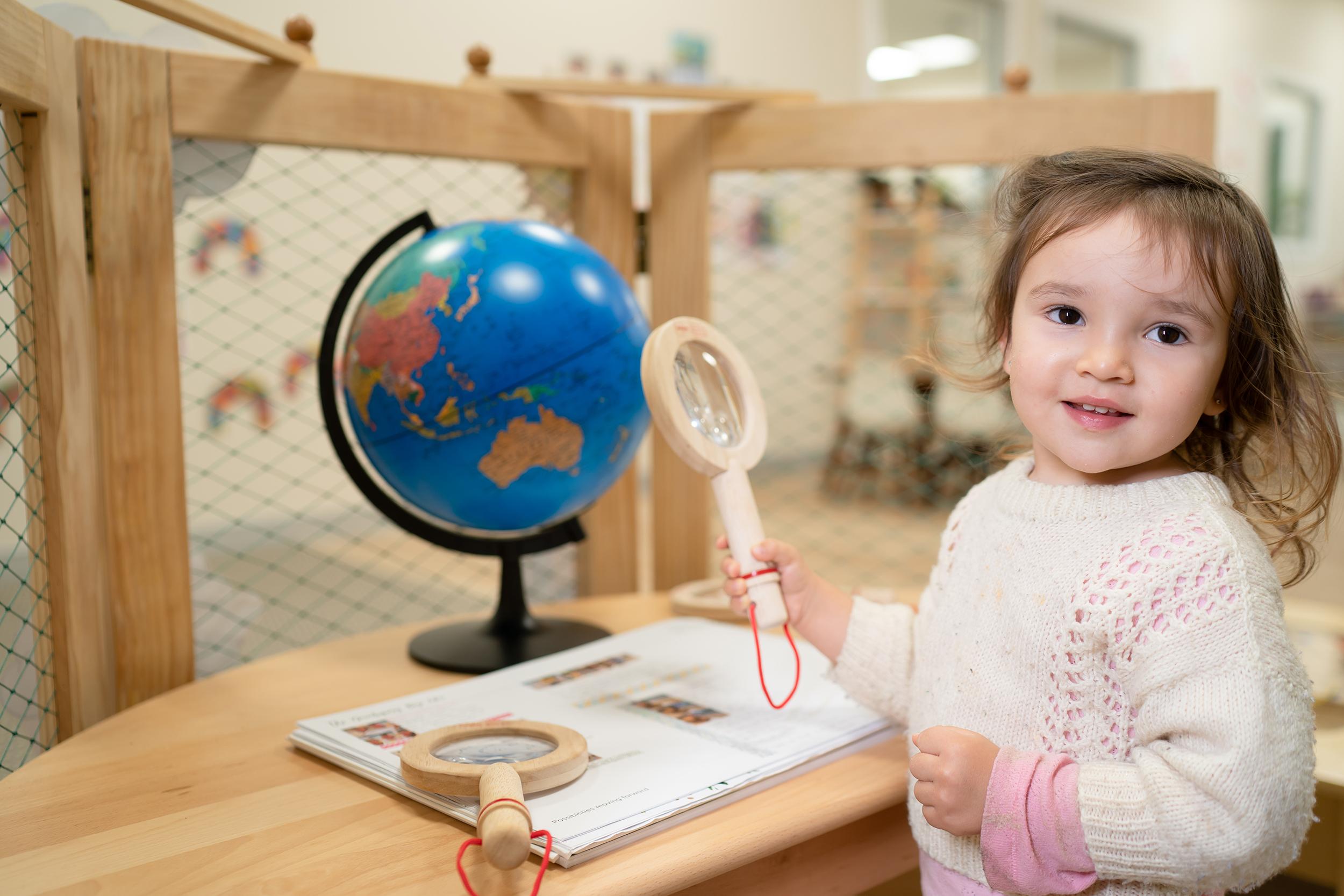 Girl looking at globe