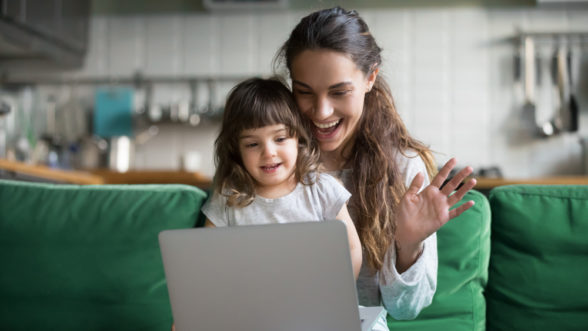 mum and daughter on laptop